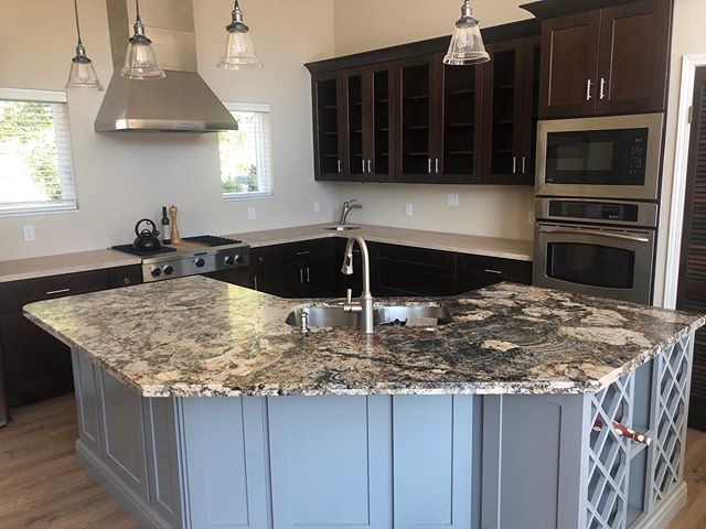 Perimeter counters in Limestone • Island in leathered granite #kitchendesign#kitchencounters#granite#leathered#leatheredgranite#limestone#stone#island#kitchenisland#sierrastoneinc#sonoraca#shoplocal