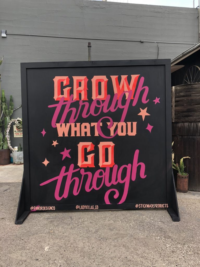 Grow Through what you Go Through hand painted, pink and black, typographic event mural for fundraiser