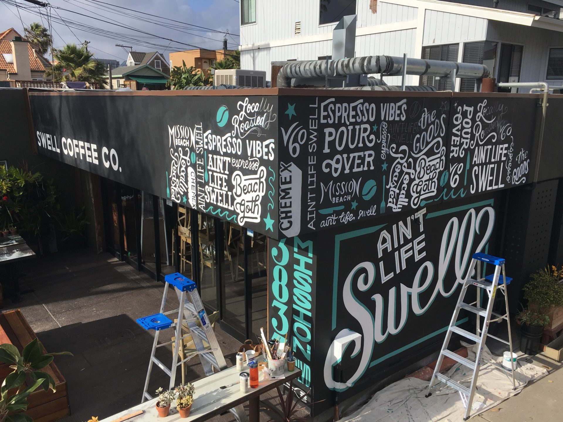 swell coffee mural and shop makeover custom, handpainted letter collage
