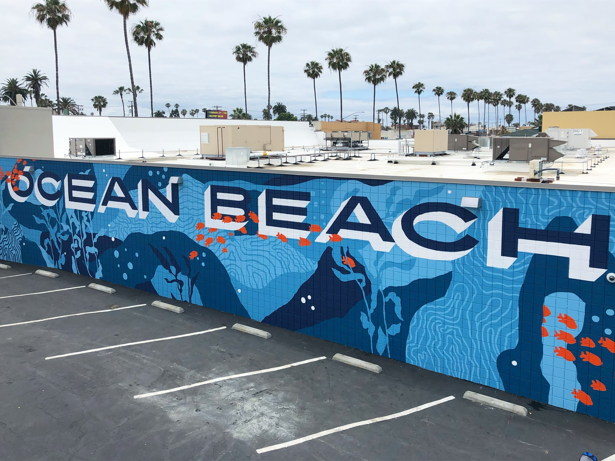 Custom Hand Painted Target Ocean Beach Mural with Lettering, Coral, Seaweed, Fish, and Waves by Pandr