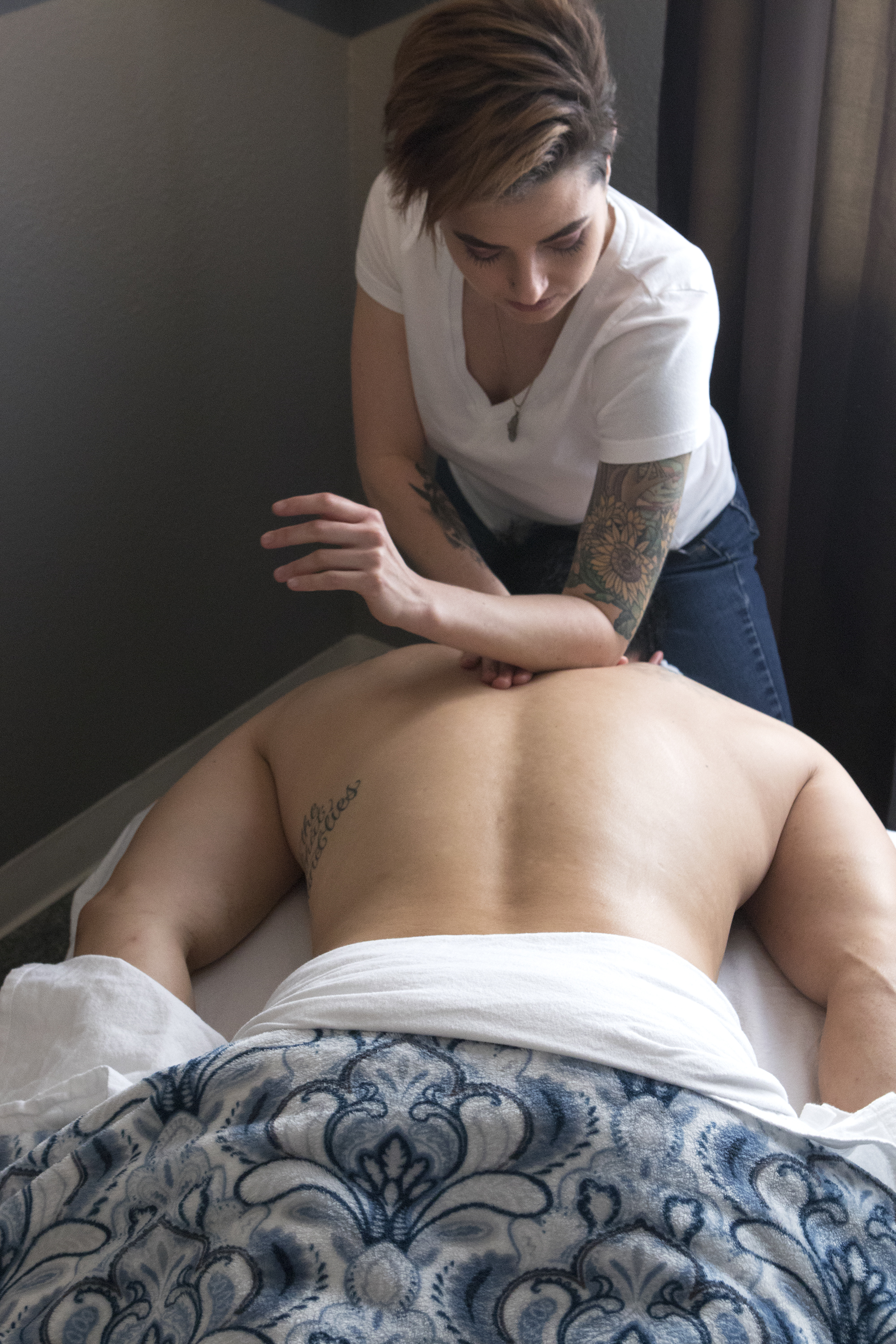 Deep Tissue - Deep Tissue Massage is a form of bodywork that aims to relieve tension in the deeper layers of tissue in the body. Deep Tissue Massage is a highly effective method for releasing chronic stress areas due to misalignment, repetitive motions, and past lingering injuries. Due to the nature of the deep tissue work, open communication during the session is crucial to make sure you don't get too uncomfortable. Keep in mind that soreness is pretty common after the treatment, and that plenty of water should be ingested to aid with the flushing and removal of cellular debris that will have been released from the deep tissue during the session.