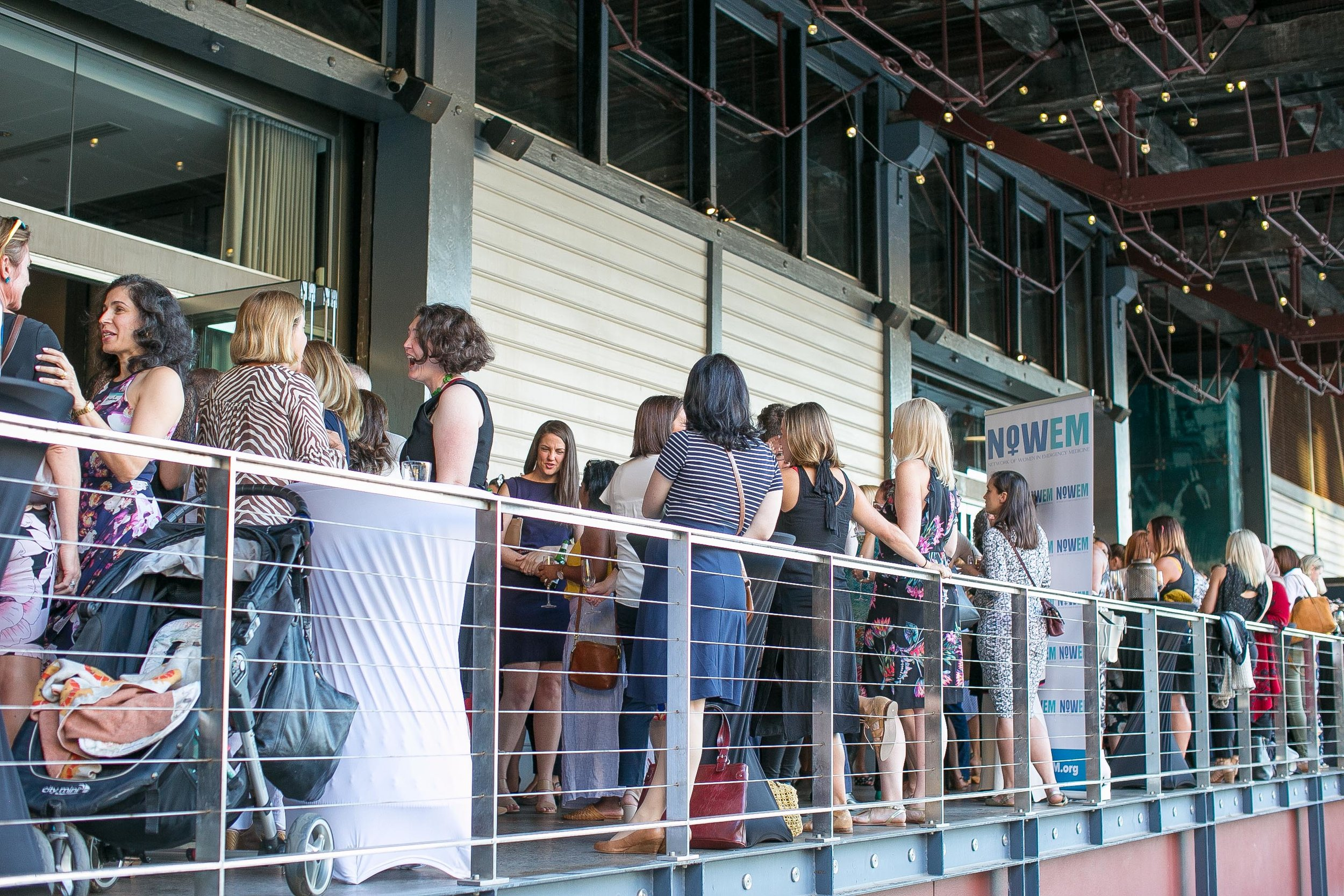 Crowd chatting on terrace 2.jpg