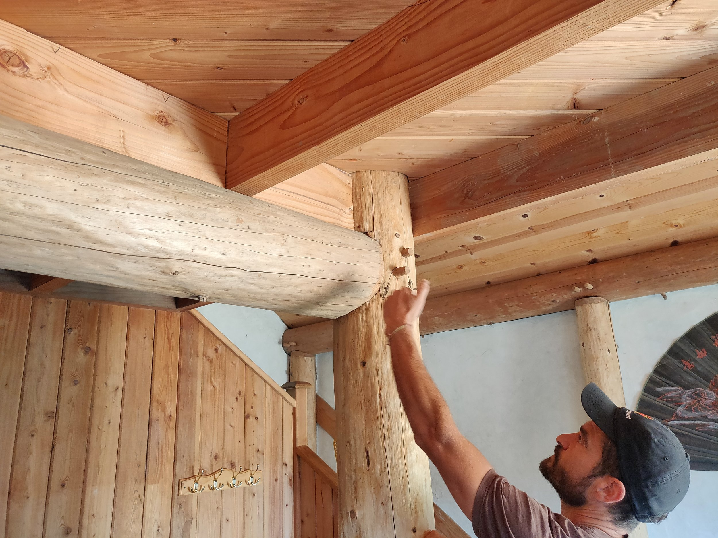 Collin Gillespie, of   Polecraft Solutions  , showing sturdy wood dowel joinery on the interior of a round wood framed, earth plaster home he helped to design.