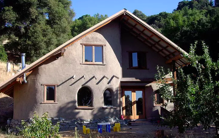 Cob infill with natural fire resistant clay plaster glazing surround small diameter pole timber framing. Designed, engineered and built by FRG members Colin Gillespi and Eric Lassotovitch, and friends.  Image credit: Colin Gilespi