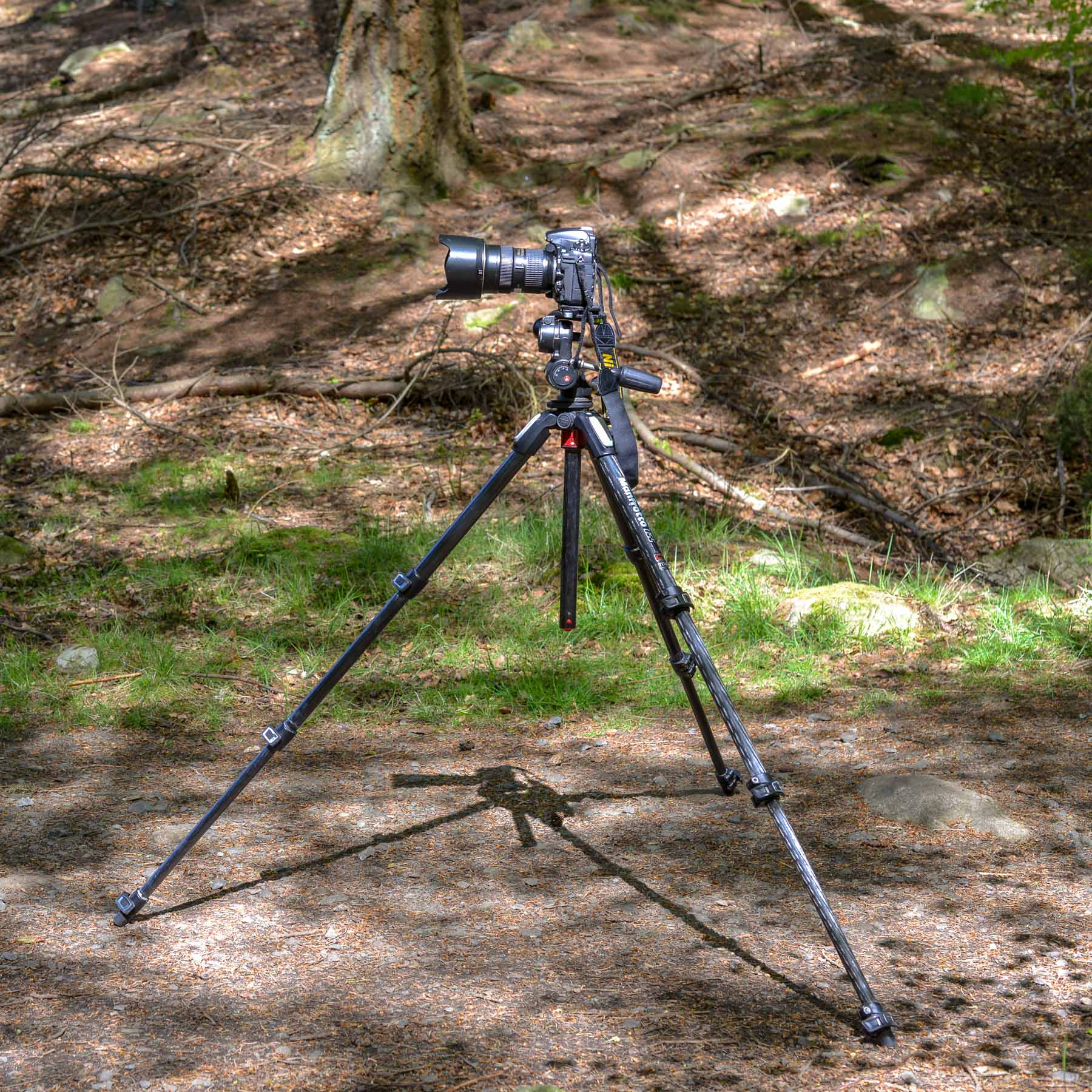 Set the front leg of the tripod directly underneath the lens.