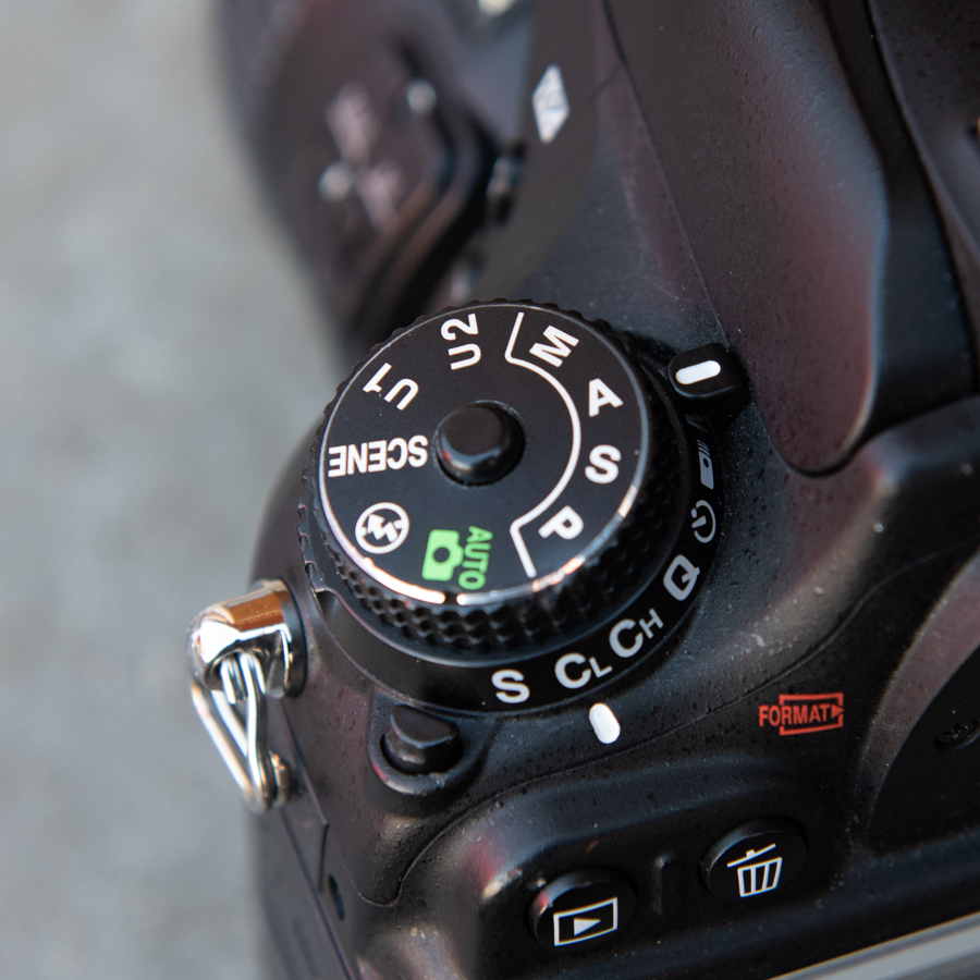 A (Av) - You set the Aperture and the camera automatically selects the Shutter Speed.