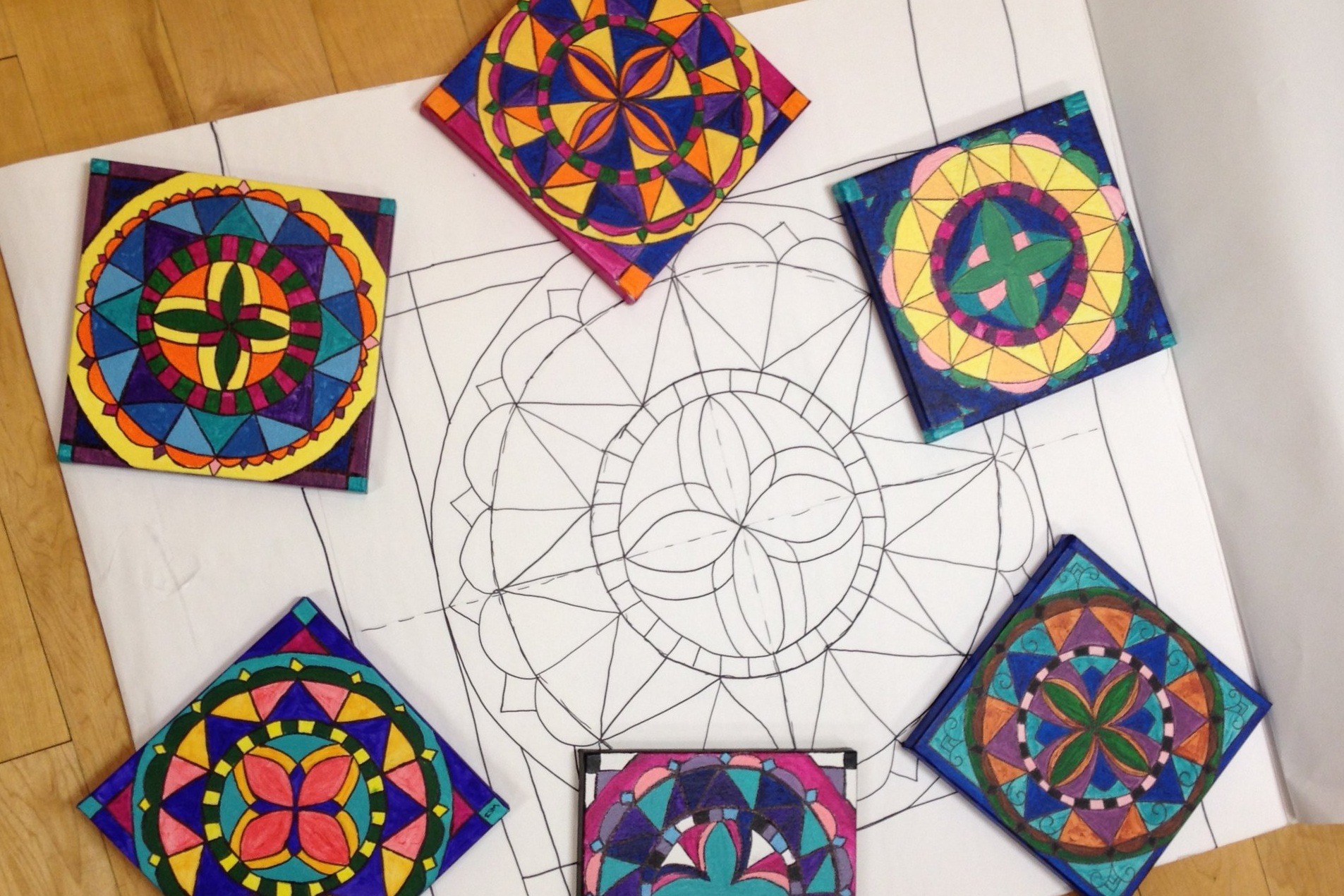 Canvases created at a previous Mandala Painting Party