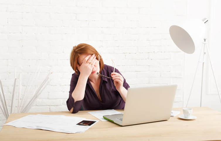 middle-aged-woman-headache-at-computer-2.jpg