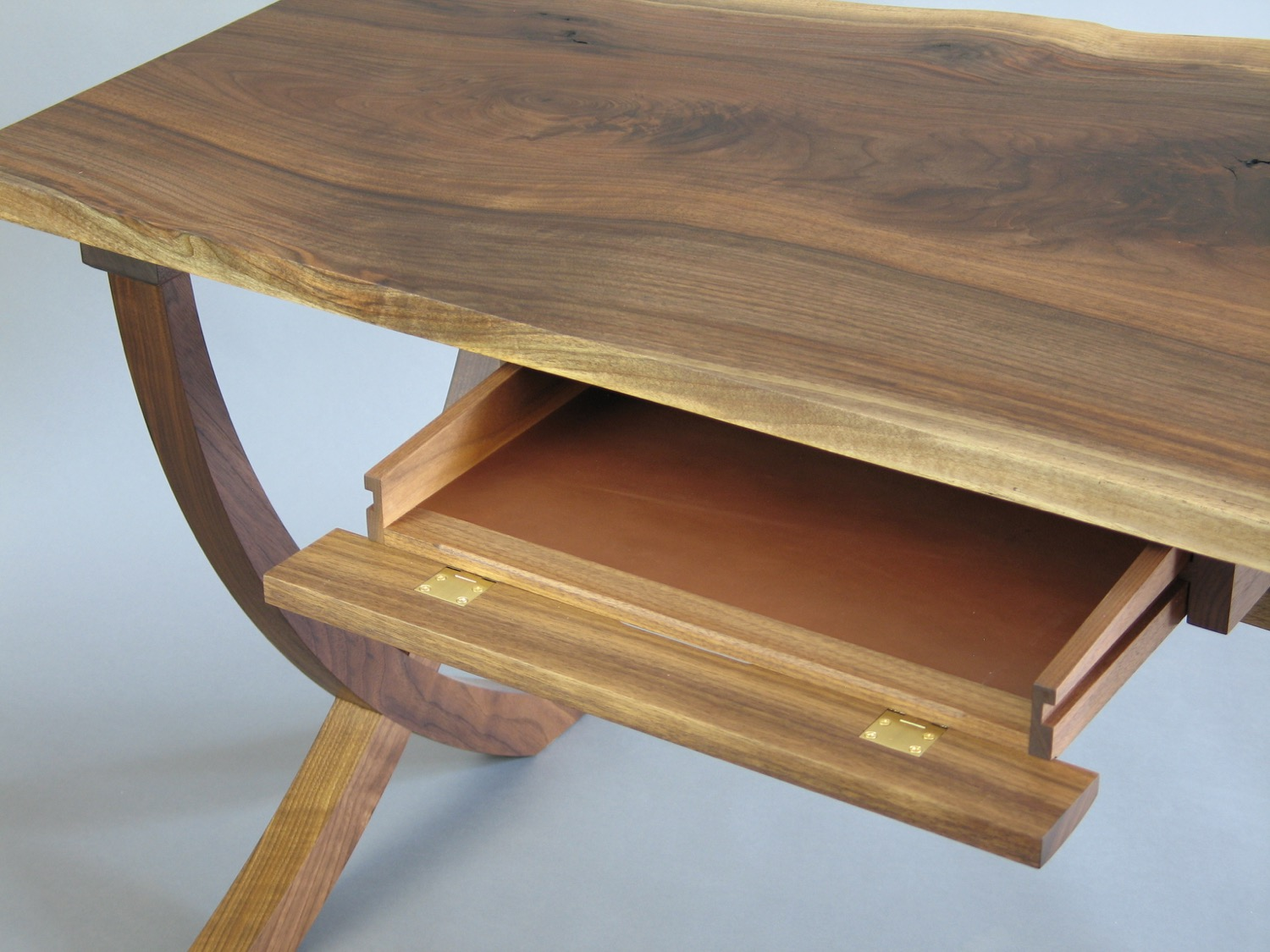 Beck desk detail - walnut with leather-lined keyboard pull out