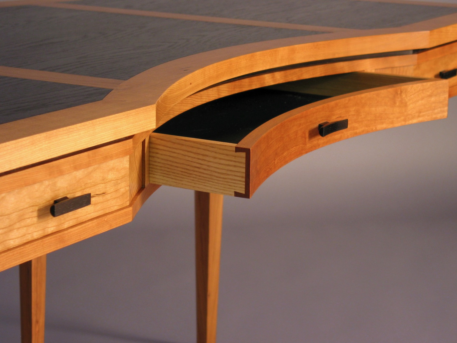 Ridge desk detail - cherry, bog oak, ash, leather lined dovetail drawers with hand-carved drawer pulls