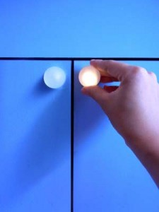 Glowpull, a smart cabinet knob, when touched
