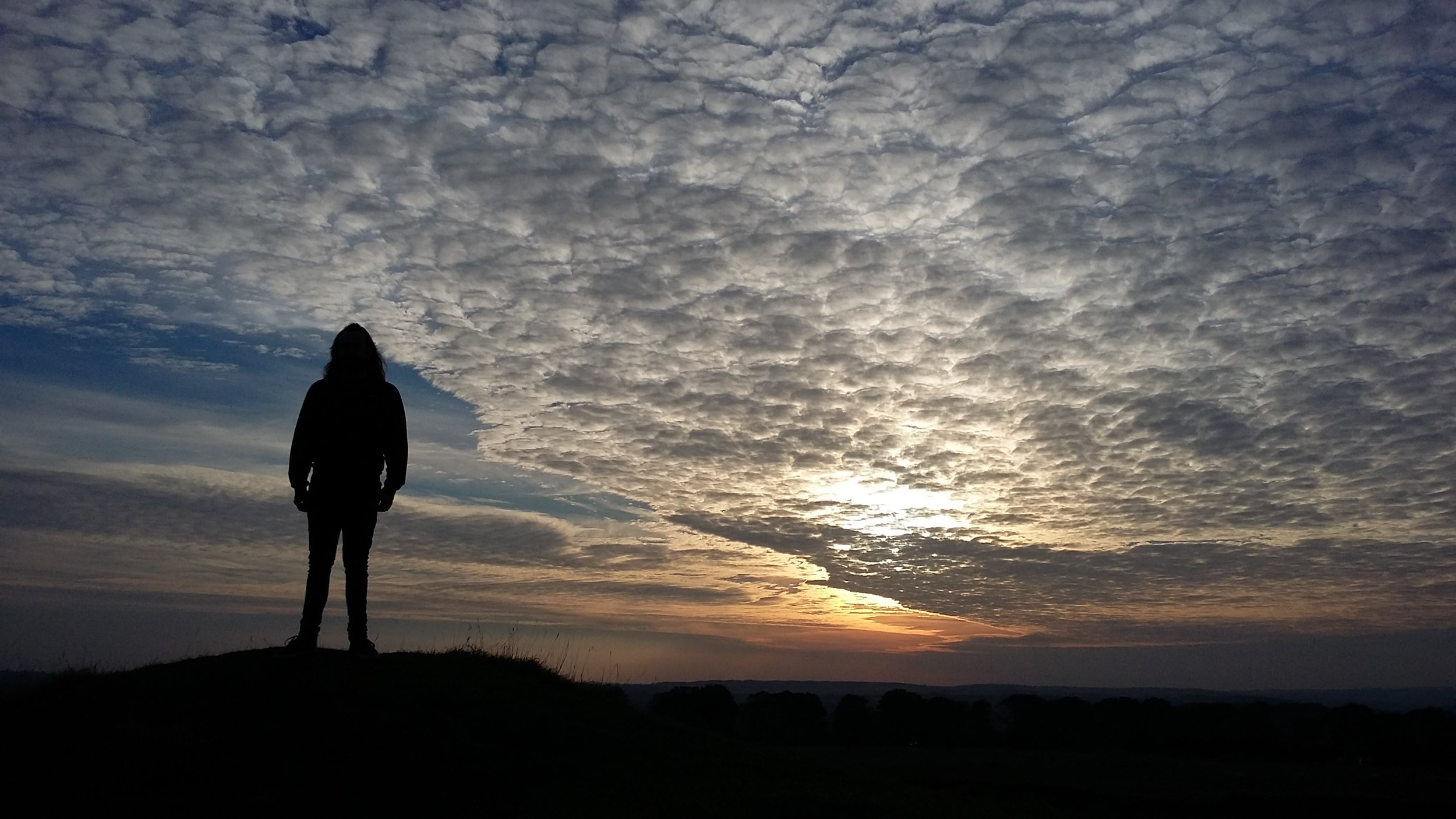 Astride the Iron Age hill fort of Badbury Rings, Dorset, 2015