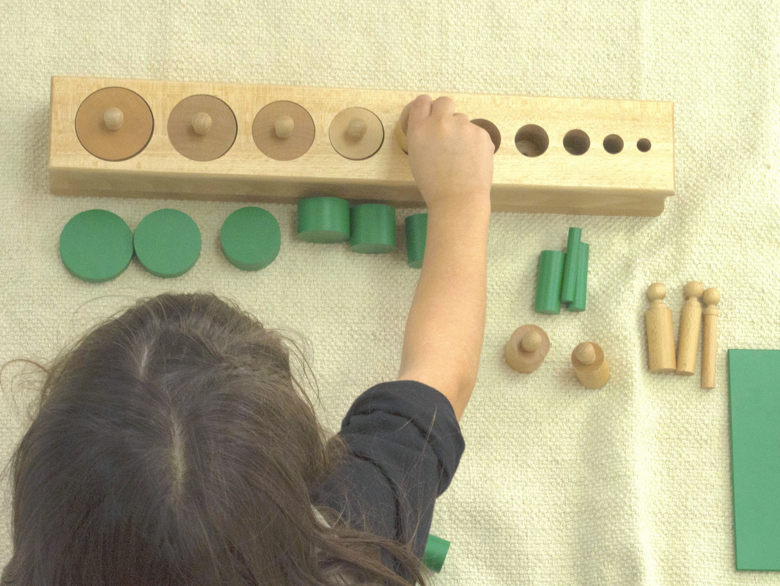 Sensorial - The Sensorial materials enable the child to explore and identify, compare and contrast, recognize similarities and differences and classify sensory impressions in relation to size, color, temperature, texture, scent, taste, pitch, and more.