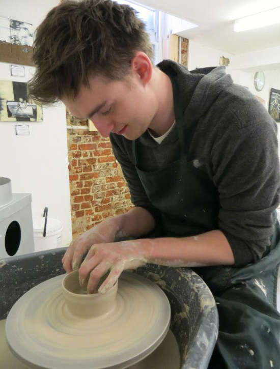 michael throwing the pottery experience team building activity.png