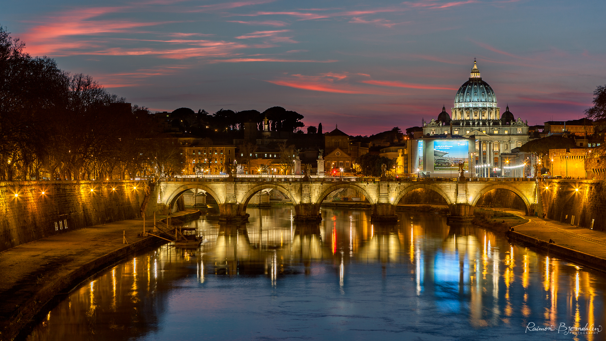 View of St. Peters basilica from the Ponte Umberto I bridge in Rome, Italy.
