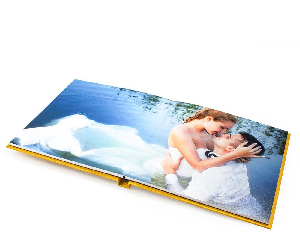 Photo Books & Albums - Elegant high-end photo books and albums. All made with thick durable photo paper. Lay flat Books and Albums come in a variety of sizes and cover choices.