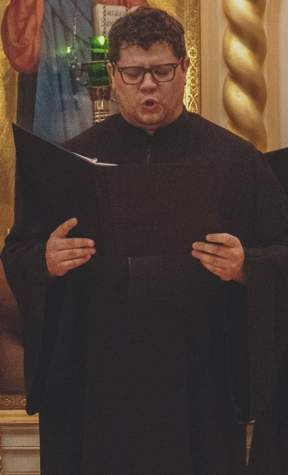 Samuel Herron, Director - Samuel Herron began studying Byzantine Music under Leonidas Kotsiris in 2002. In 2006, he spent three months studying under Lycourgos Angelopoulos, Archon Protopsaltis of the Archdiocese of Constantinople, Protopsaltis of Hagia Eirini in Athens, and director of the Greek Byzantine Choir, which Samuel performed with as an isokrates while living in Athens. From 2015-2017, he studied under Fr. Romanos Karanos while attending Hellenic College.Samuel has served as the Lampadarios of Holy Trinity Greek Orthodox Church in Nashville, TN from 2007-2009, as Protopsaltis of Annunciation Greek Orthodox Church in Chattanooga, TN from 2010 to 2015, as Protopsaltis of Annunciation Greek Orthodox Cathedral of the New England Metropolis in Boston until May 2017, as Ieropsaltis for Holy Trinity Greek Orthodox Cathedral in Phoenix, AZ until September 2018, and currently serves as Protopsaltis of Assumption Greek Orthodox Church in Scottsdale, AZ. Samuel received his Certificate in Byzantine Music with a grade of Excellent in 2015 from Holy Cross Greek Orthodox School of Theology. He has performed with the choir of Protopsaltis George Theodoridis, the Psaltikon Ensemble directed by Dr. Spyridon Antonopoulos, the Archdiocesan Byzantine Choir directed by Demetrios Kehagias, Capella Romana directed by John Michael Boyer, and the Holy Cross St. Romanos the Melodist Byzantine Choir directed by Fr. Romanos Karanos.