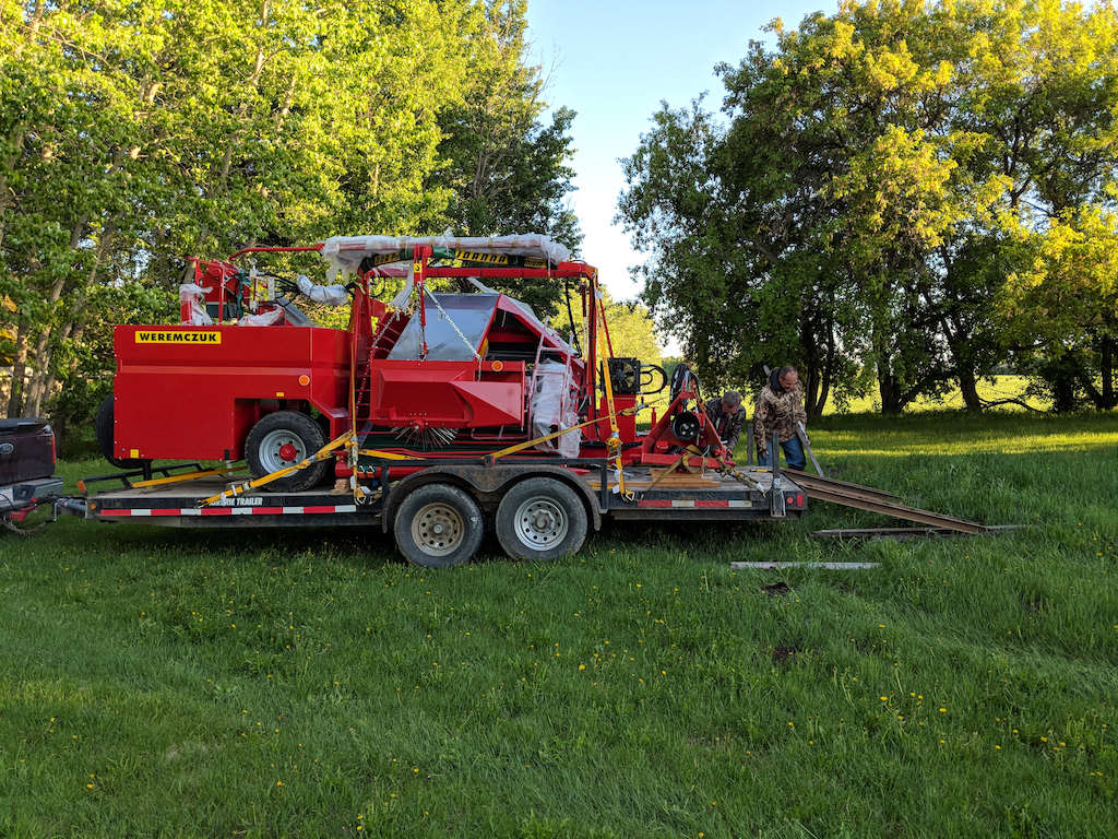 - This harvester was ordered from Poland in January, 2018, and finally arrived in Canada in June via ship to Montreal, and then rail to Calgary. It was then trailered to Debden. It had to be assembled, cleaned and oiled before the first use.