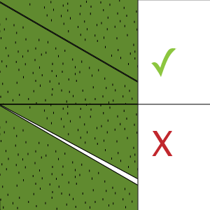 10) Fold the grass onto the tape - Making sure the edges of your grass line up seamlessly together. Lay a length of timber onto the join with some heavy objects on top to ensure the grass is firmly applied to the tape
