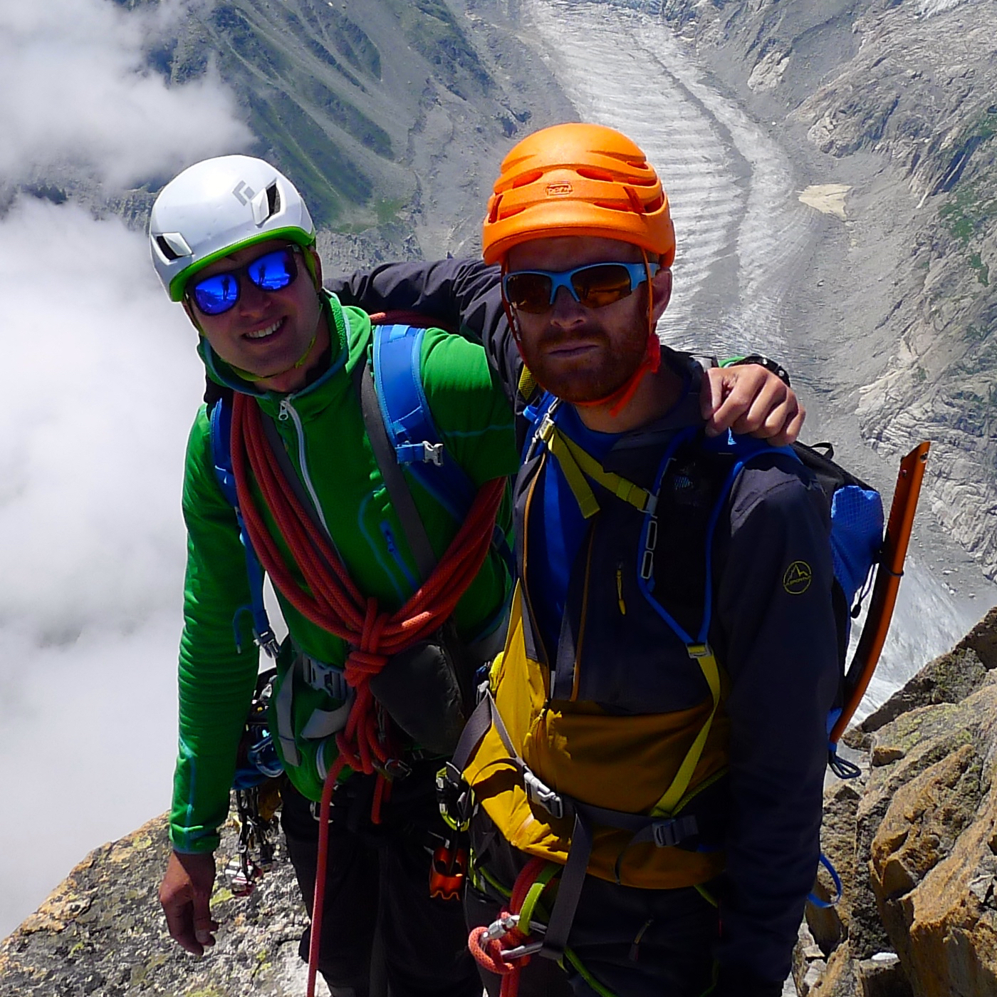 Sam and Neil near the summit of the Dru. The Panorama behind stretches all the way from the Grande Jorasses on the left to Mont Blanc on the right..jpg