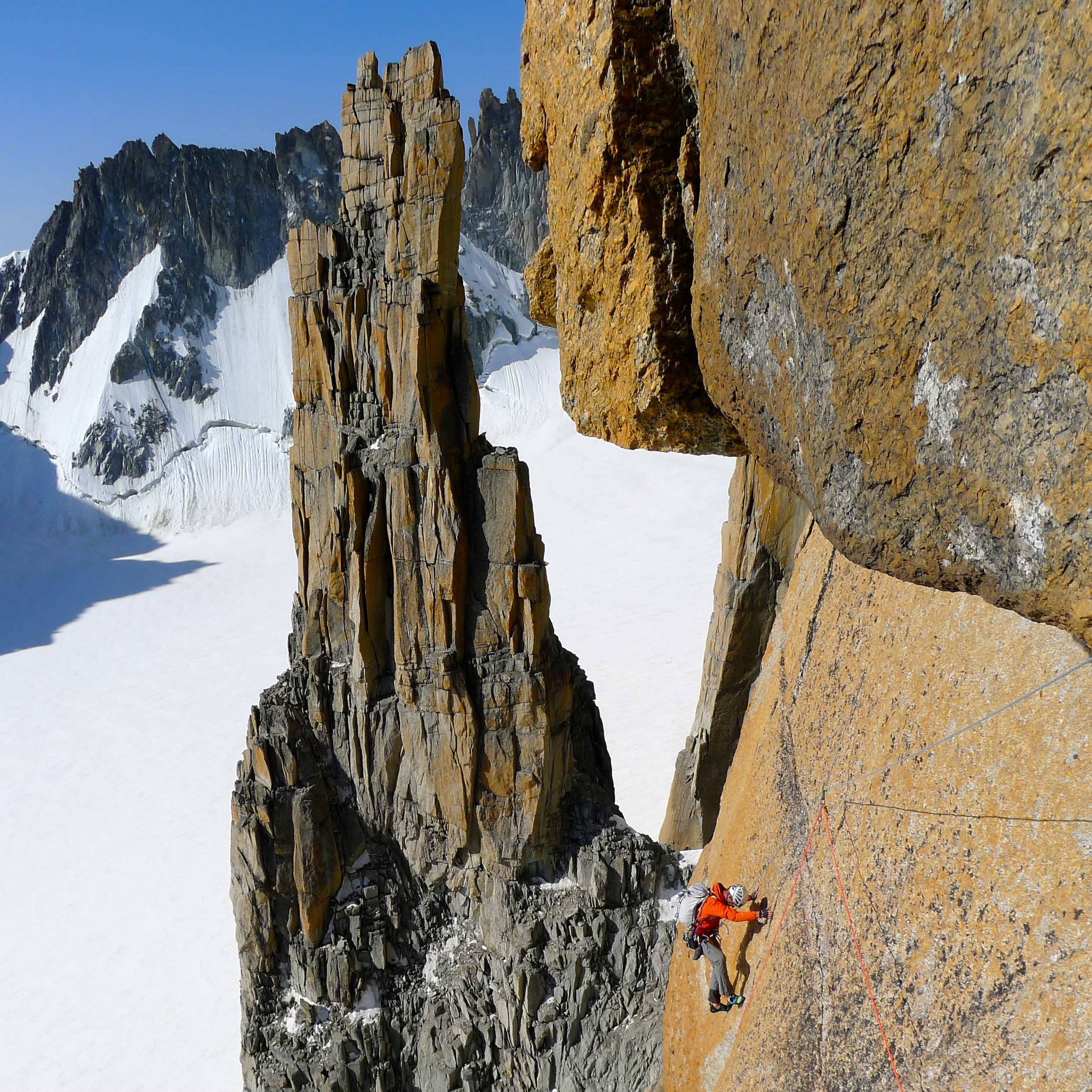 Will moves across an exposed slab on the Bonnati route Grand Capucin Mont Blanc.jpg