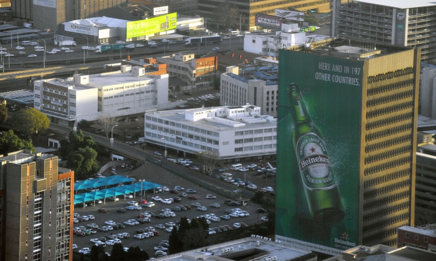 A Heineken ad in an inner city area of Johannesburg in South Africa. Photograph: Alamy