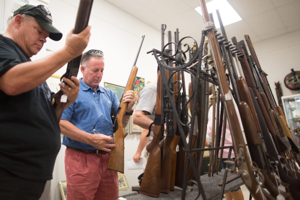 Guns and antique military paraphernalia were the featured items at the August 21 auction. During the preview time, potential buyers inspect every aspect of the lots to ensure they know what they are bidding on .