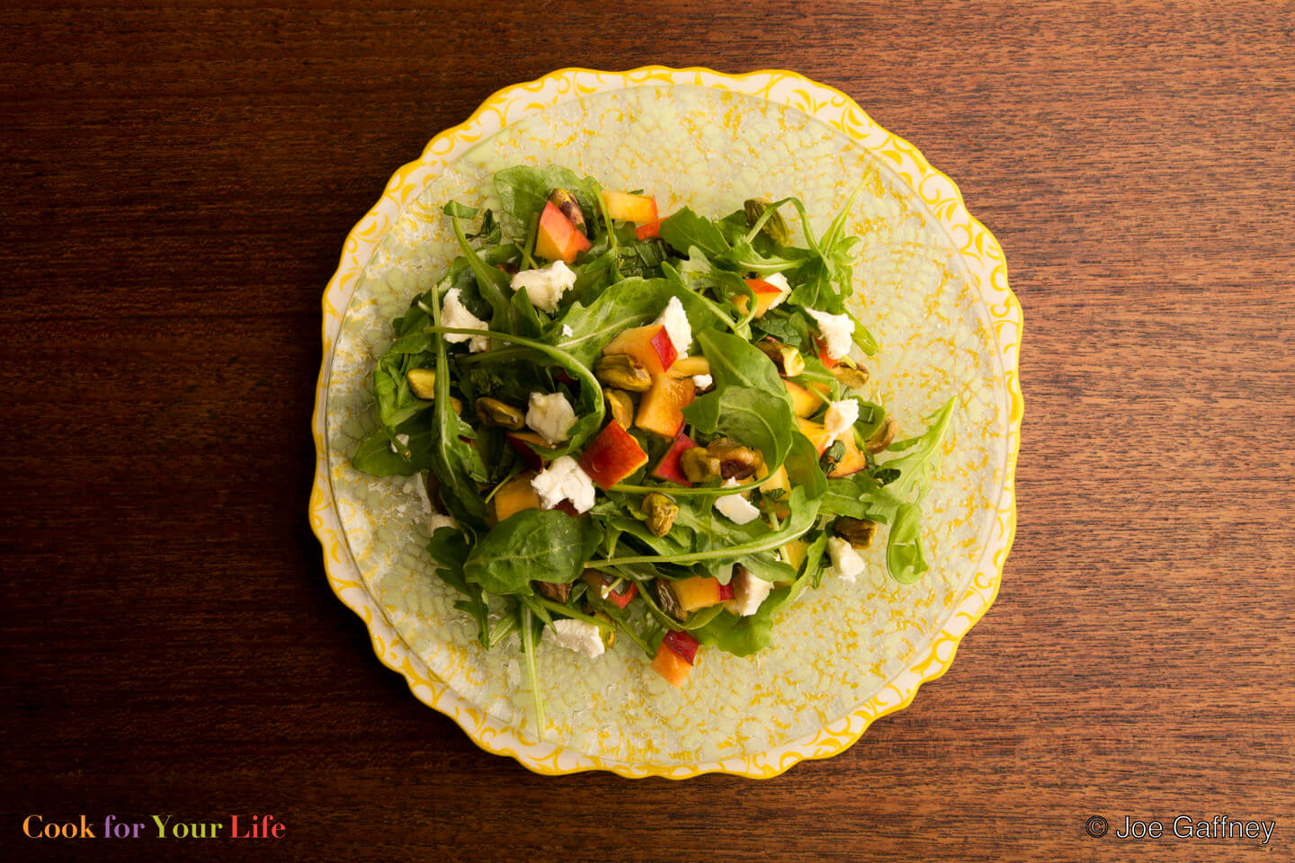 """Peach & Arugula Salad - """"Peach and Arugula salad brings the peppery bitterness of cruciferous arugula and the sweetness of ripe peaches together in a match made in heaven. Throw in the salty tang of feta, and you have an easy salad that's truly special.""""via Cook For Your Life"""