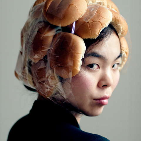 "Sooyeong Lee, ""Bun Lady,"" 2016. Performance documentation."
