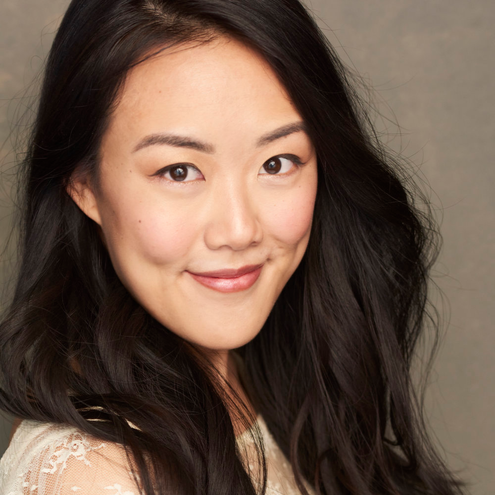"""Raechel Wong - Coveted for her curiosity, resilience, and resourcefulness, Raechel is at once the whip-smart, Rubik's Cube-solving* best friend, the kickass femme fatale in the award-winning """"Shut Up and Run,"""" and a lightsaber-wielding heroine in the recent porg™-filled AR commercial (Dayton-Faris). As the lovable, witty, and ever-helpful roommate you've always wanted to have, she'll build the fire on your spontaneous camping trip and help you cyber-stalk your crush (and she'll be there if it doesn't work out, with copies of John Wick 1 & 2 and your favorite ice cream in tow.)A veritable Swiss-army knife, Raechel is competitively well-rounded, equipped with artistic instincts from painting and music; the discipline of athletic training in volleyball and lindy hop; and the epicurean tastes of a hole-in-the-wall foodie. When not pursuing one of her many interests, she's collecting stamps in her passport and solving all the puzzles in the in-flight magazine.*Her fastest time is 00:01:09"""