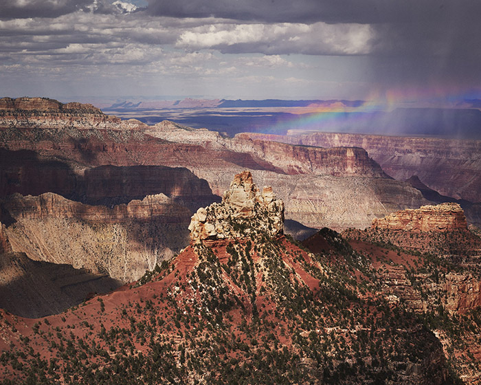 A classic example of waiting for the weather. We'd just had an intense storm in the Grand Canyon North Rim, and waiting for 15 minutes gave us this absolutely unbelievable rainbow over the rock!