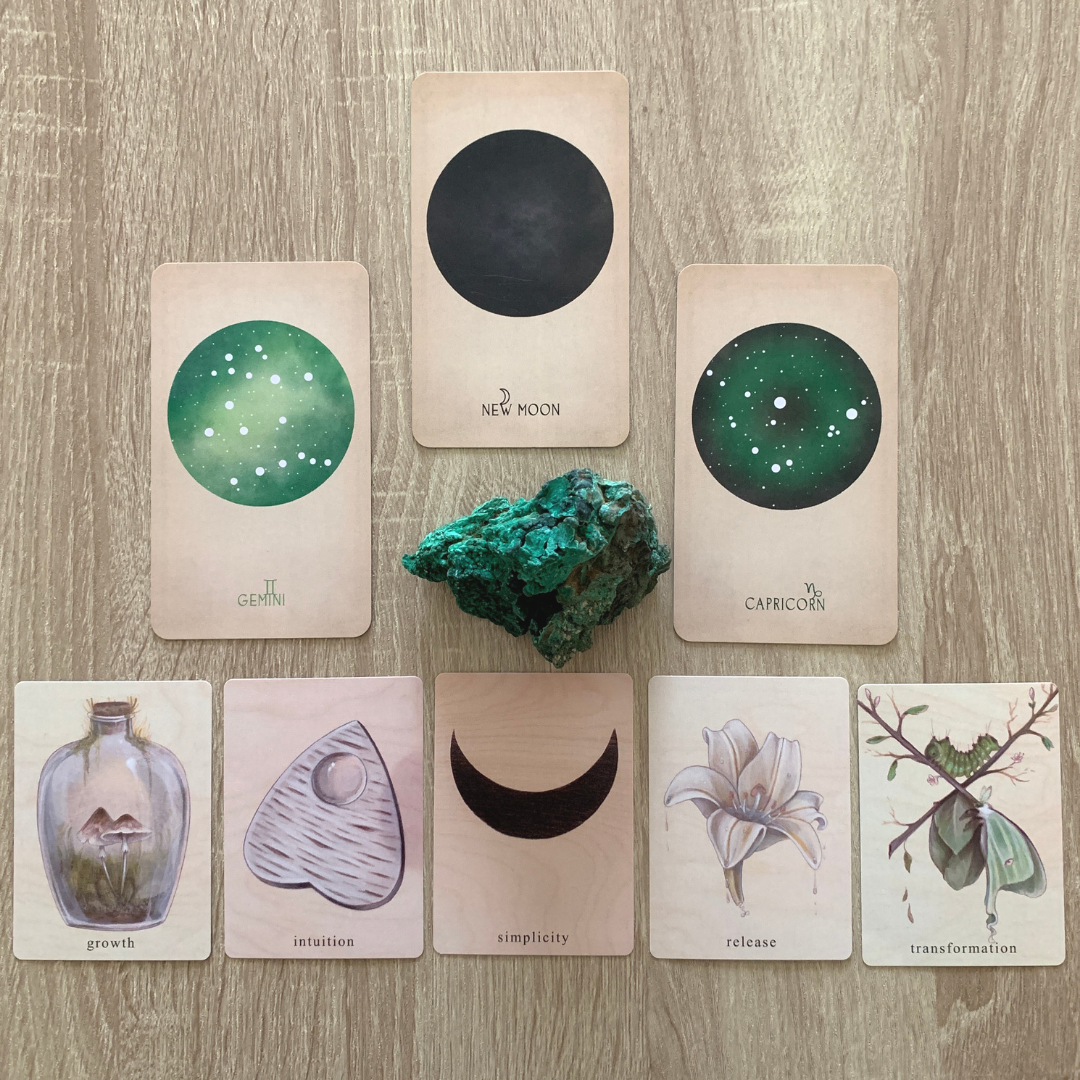 Two examples of Oracle card decks highlight their differences. The first is The Arcana of Astrology by Black and the Moon, the second is The Earthbound Oracle by skull Garden.