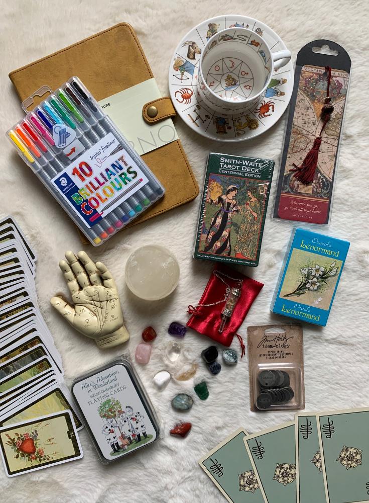 Divination journal, astrology, fortune telling teacup, crystal ball, casting charm pack, Tarot deck, lenormand deck, cartomancy, lithomancy, palmistry, dowsing pendulum. .png
