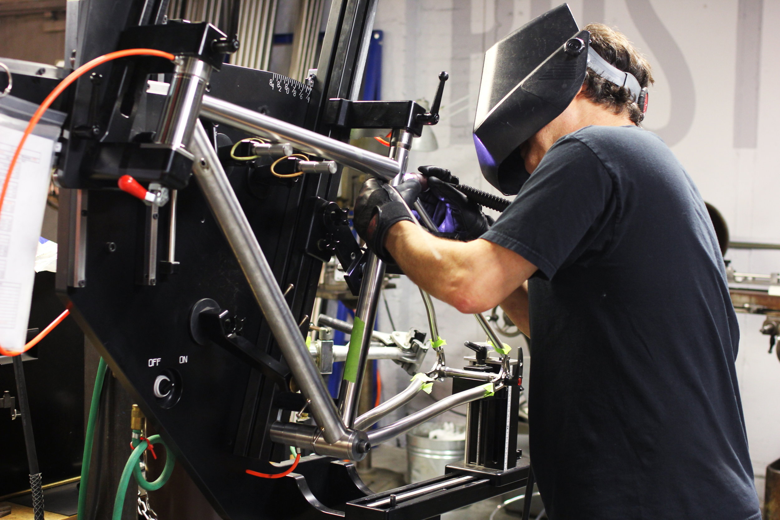 Photo of welder using Multi-Etch on a Firefly Bicycle frame.