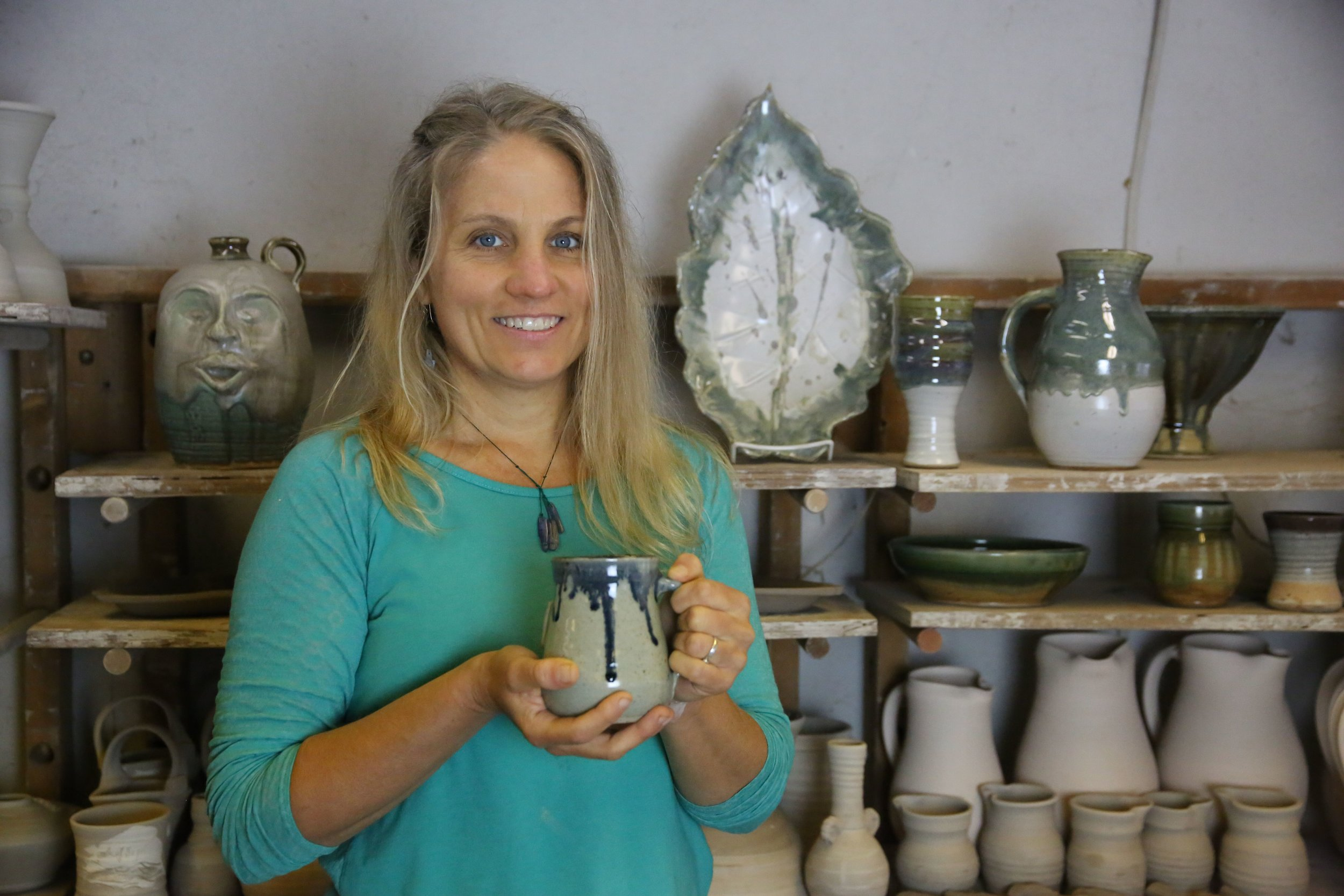 Betsy Ledbetter   Betsy began making pots in 1998 when she enrolled in a beginning wheel class at The Gibbes Museum of Art in Charleston, SC. At the time she was doing an Internship with the museum to complete requirements to graduate from The College of Charleston. After graduating, Betsy moved to the North of the state and eventually began commuting to White County where she had the privilege of using the studio of Jessie Meaders to begin cultivating what she had learned in the brief class at The Gibbes.