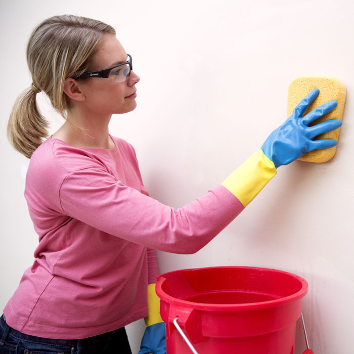 cleaning the wall with sponge.jpg