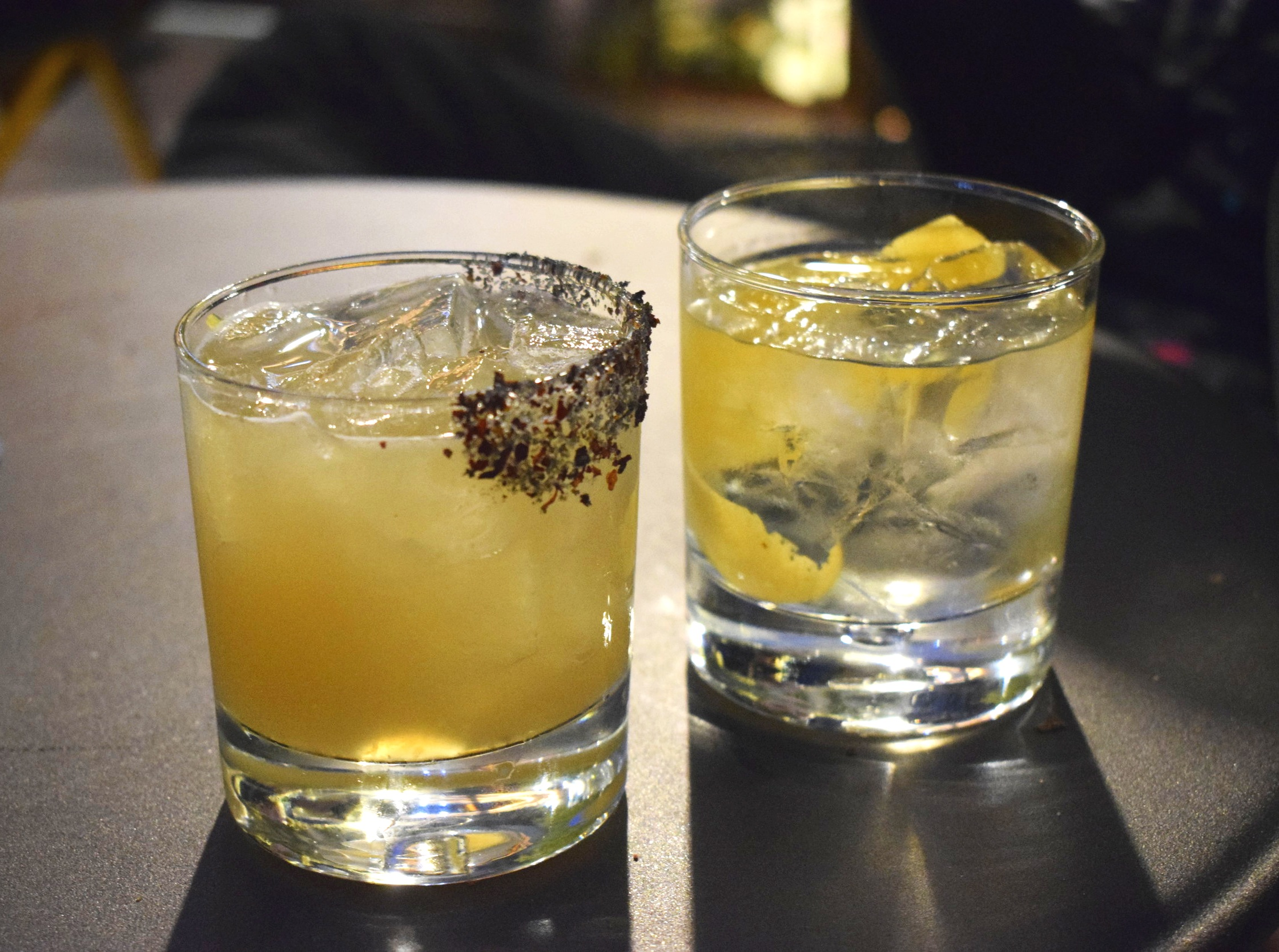 The Caddy (left) and the White Negroni (right) at Castell Rooftop Lounge | Photo Credit:  Lauren Johnson