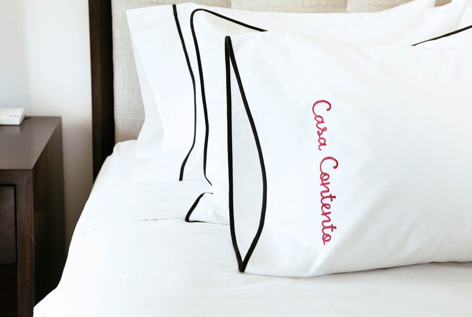 Pillowcase with binding and embroidered name in bold cursive