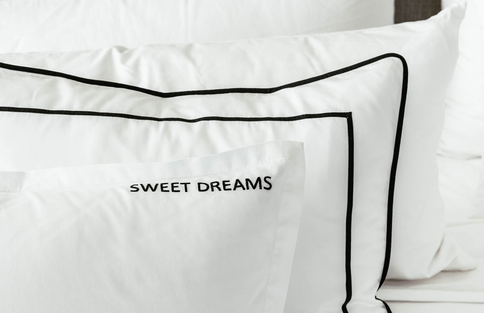 """BACK: Sham with binding and 1/4"""" framed band in black FRONT: Sham with 1"""" flange and SWEET DREAMS in Jeffrey font. Can be any word you desire,"""