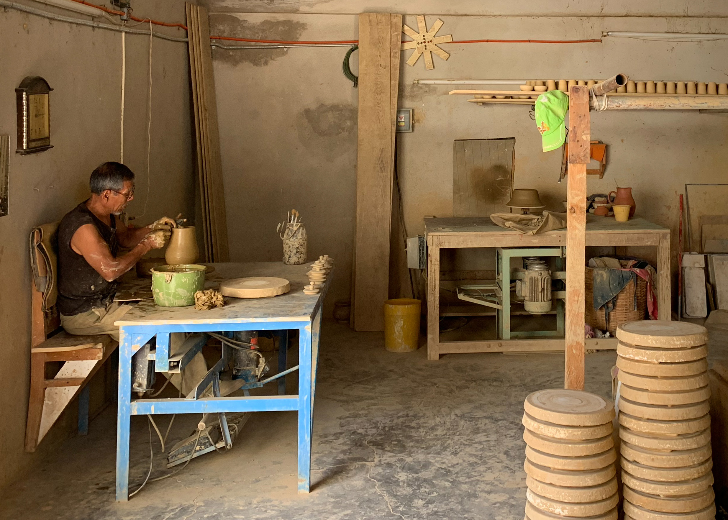 An artisan shaping a clay pitcher.