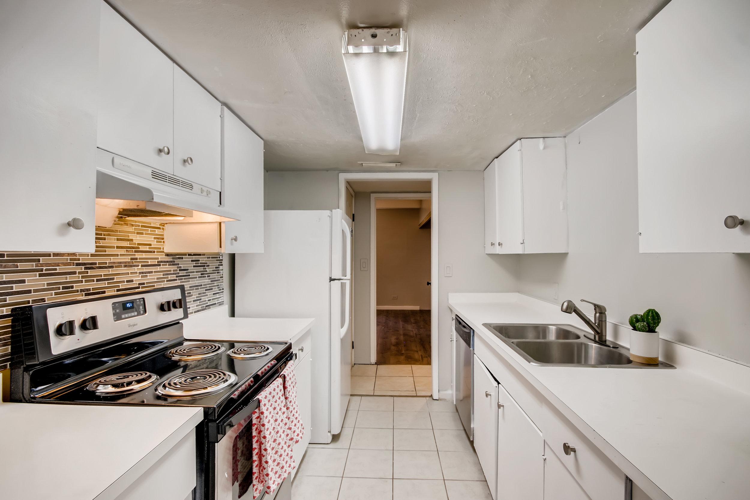 9700 E Illif Ave E48 Denver CO-print-012-015-Kitchen-3600x2400-300dpi.jpg