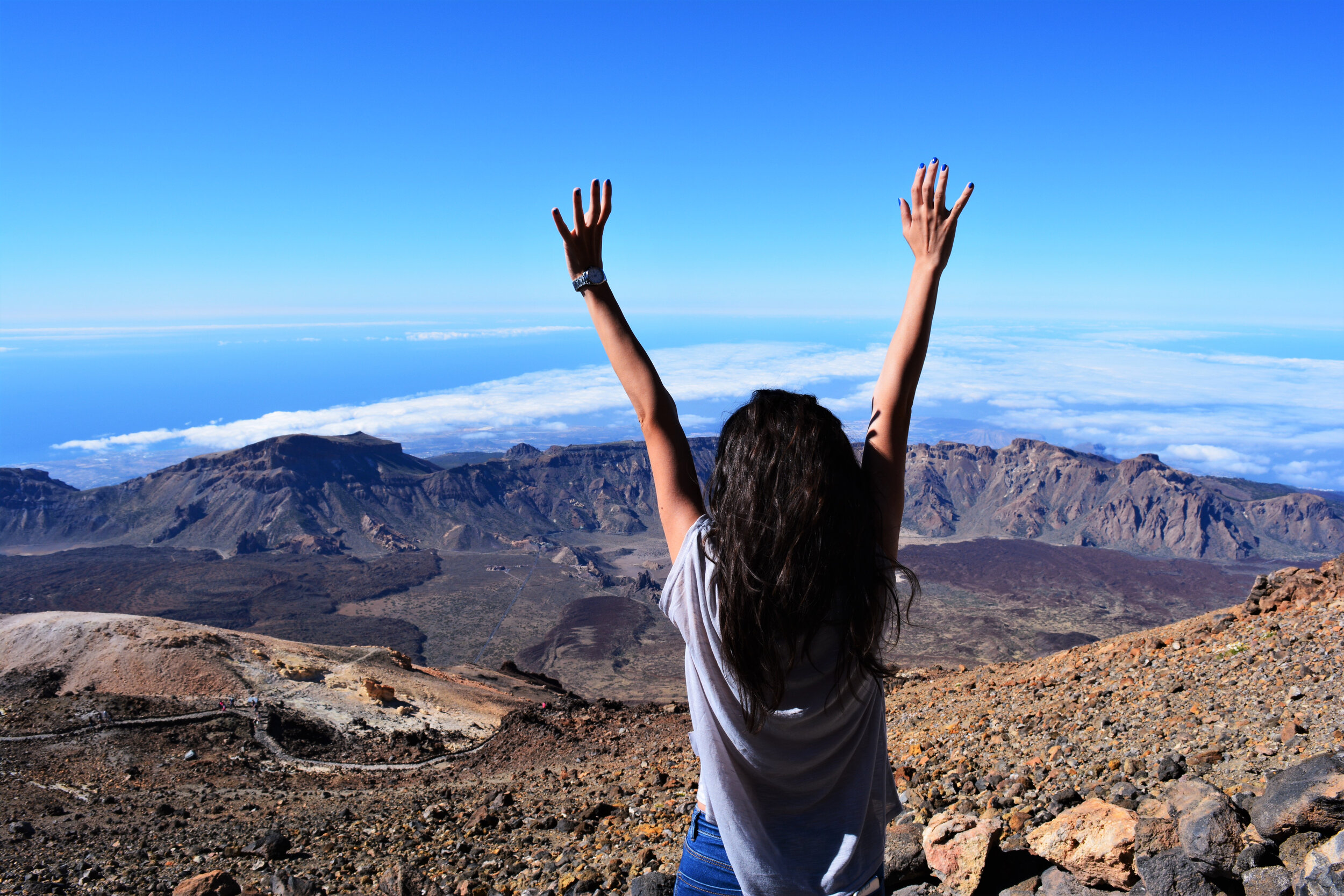 Canva - Woman Standing on Mountain While Raising Her Hands.jpg