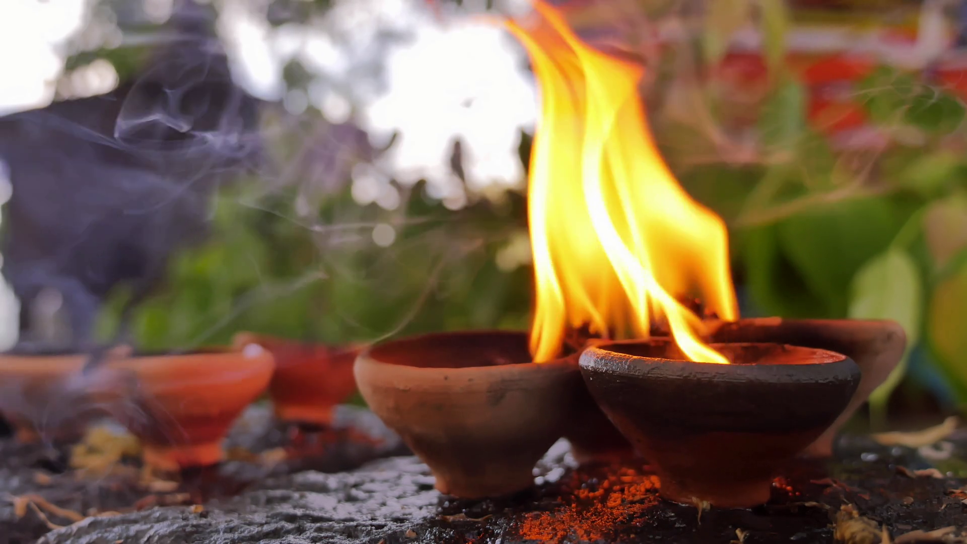 videoblocks-spiritual-background-of-burning-candles-in-buddhist-temple-flames-and-fumes-of-aromatic-oil-in-south-east-asia_sglbrk5nx_thumbnail-full08.png