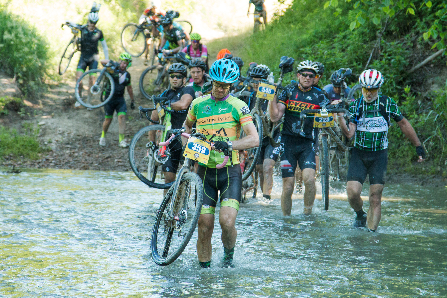 "Race promoters add ""features"" to their races such as this knee-deep water crossing which is a regular at Dirty Kanza."