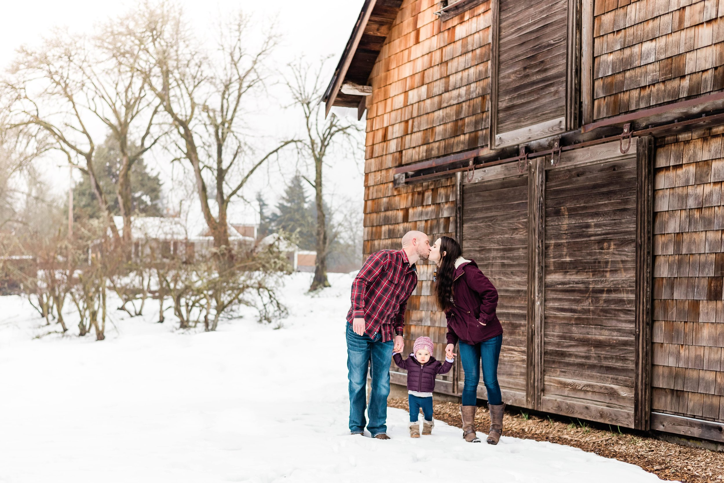 Mom and dad kissing in front of the barn at Dorris Ranch, Springfield Oregon
