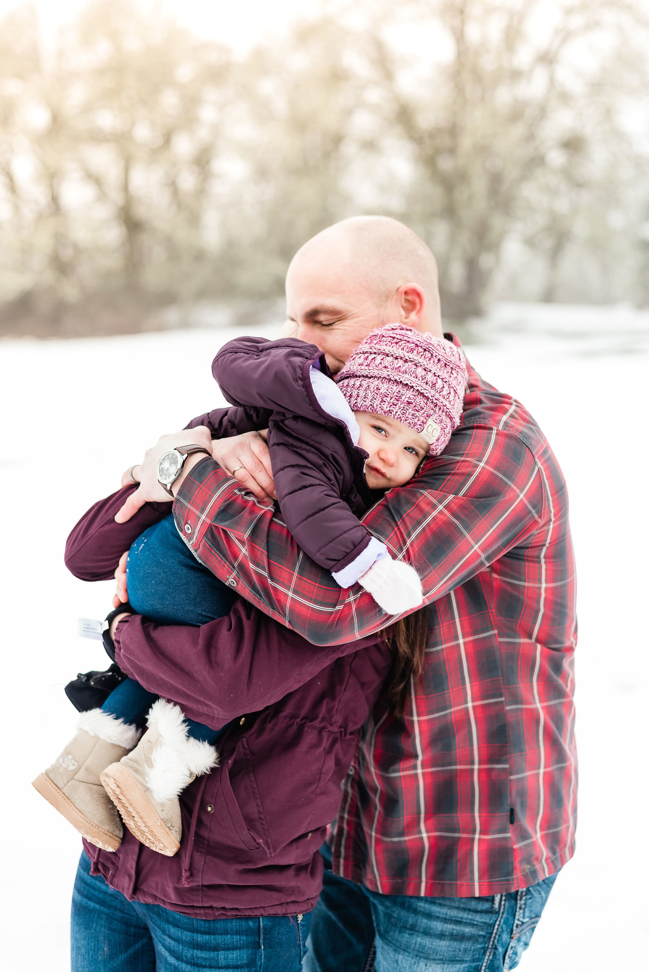 father hugging baby girl