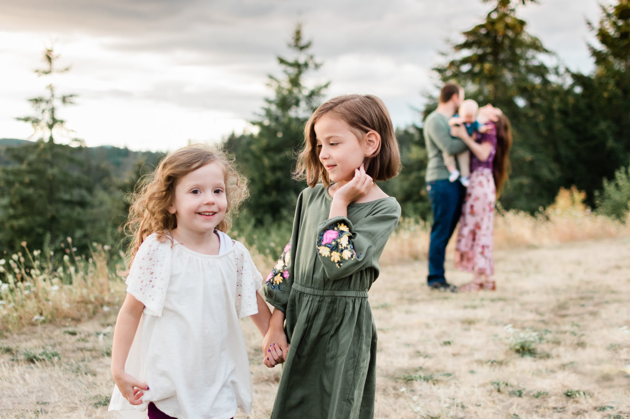 sisters posing for an adventure family session