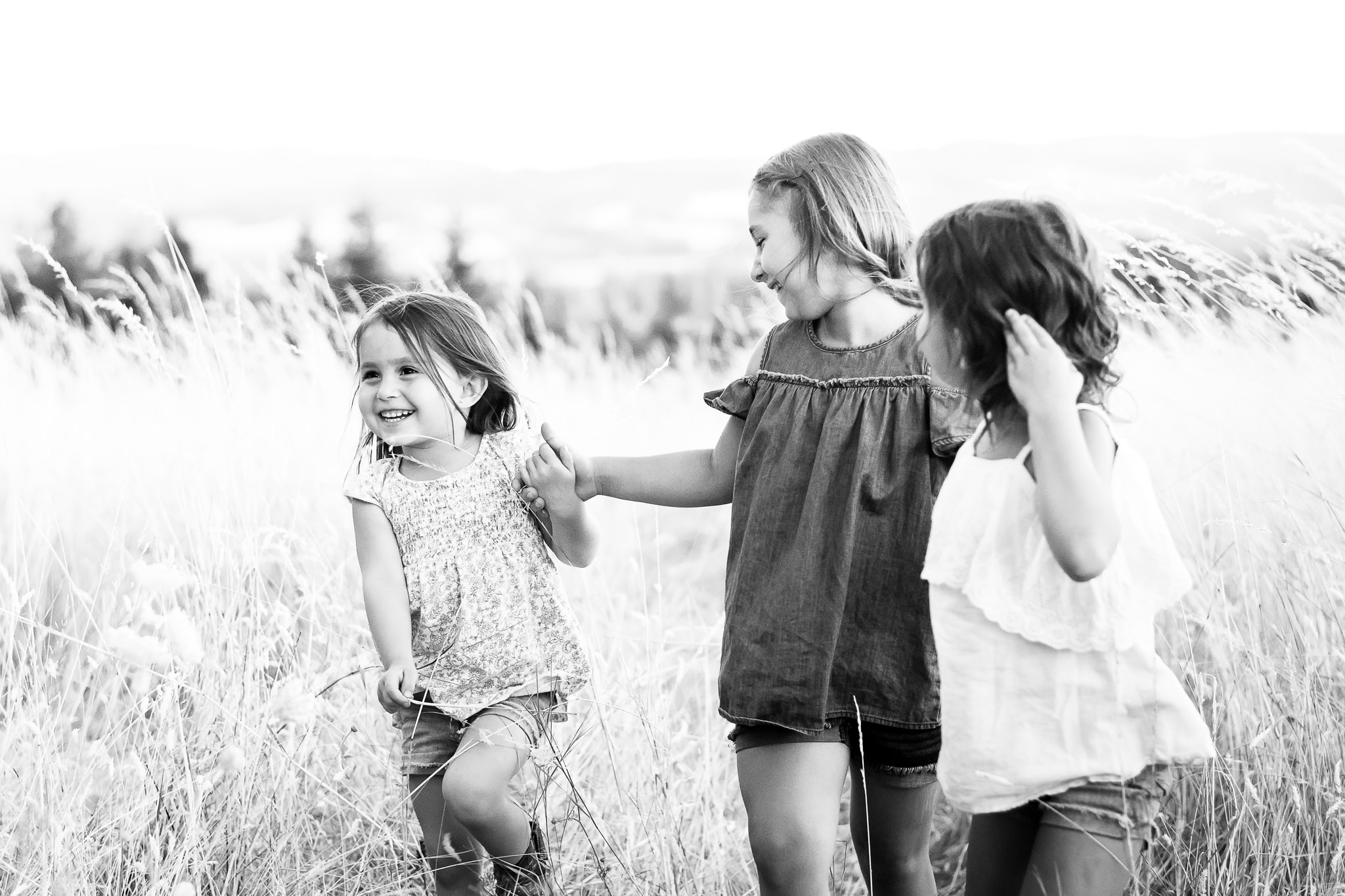 Sisters running in a field together in Beaverton, Oregon