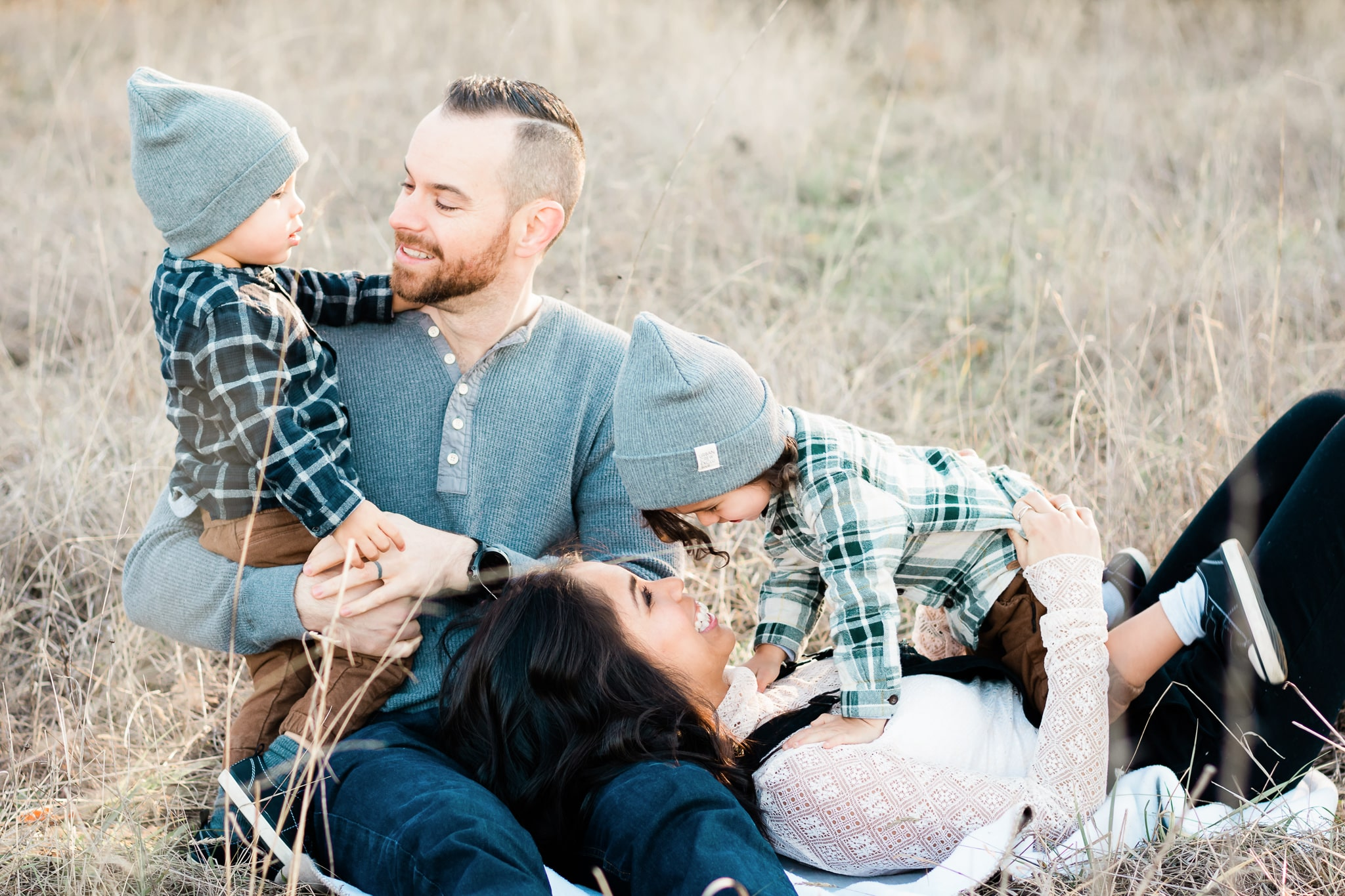 Family cuddling together during a portrait session