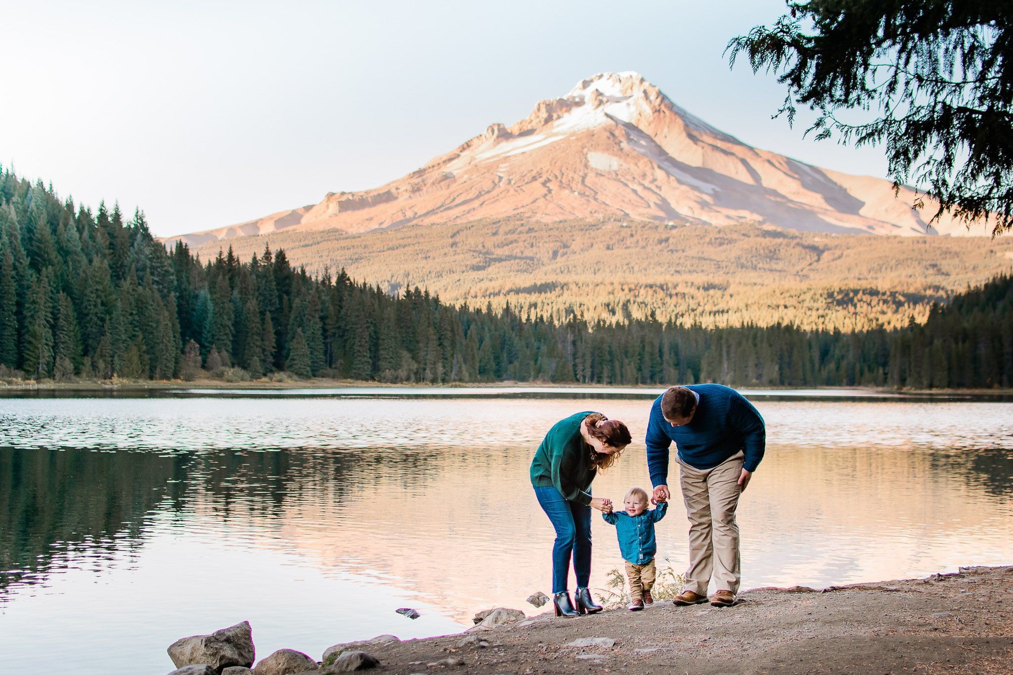 Family posing for a photo at Trillium Lake by Mt Hood.